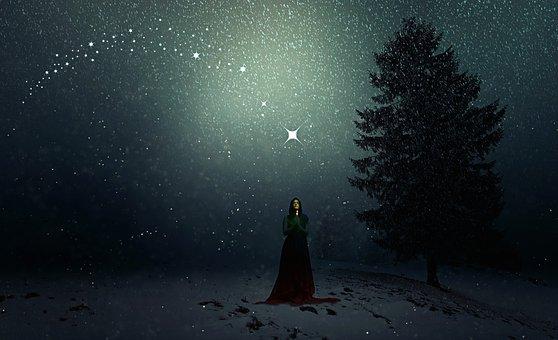 星空に祈る女性