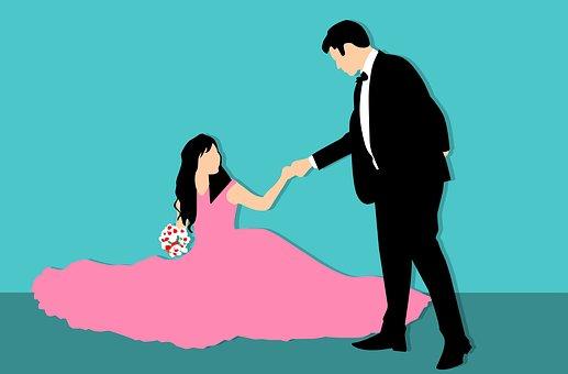 ドレスを着た女性とエスコートする男性